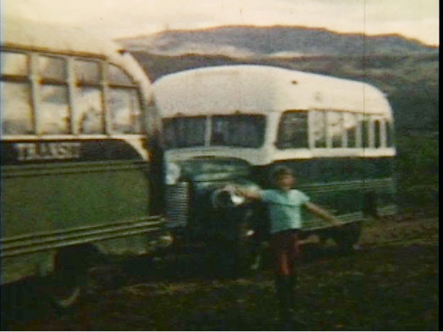 Mickey Hines in front of Bus 142 in Lignite, Alaska